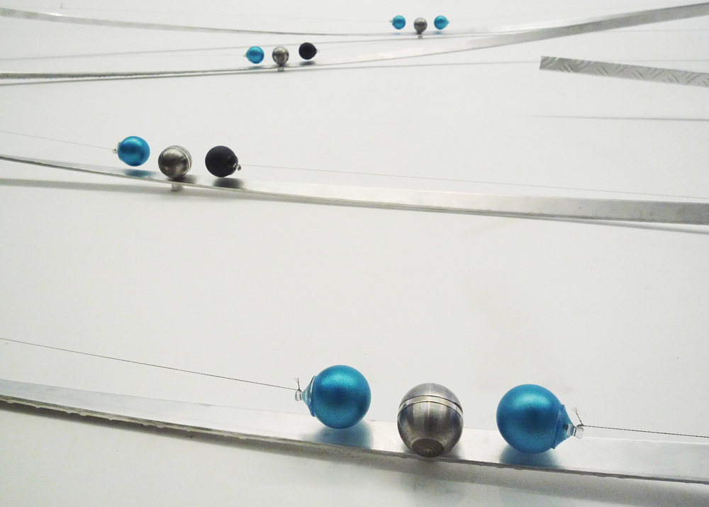 [Almond aluminium, colored ping-pong balls, wire, neodymium magnets, 600x215x25 cm]